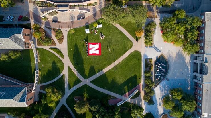 Husker flag on Nebraska campus in open green space