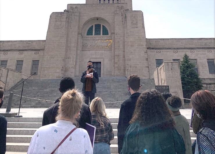 Zhou speaks at a rally outside the Nebraska State Capitol.