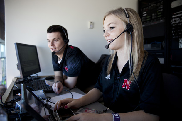Broadcasting interns work in Memorial Stadium during a 2013 football game in Memorial Stadium. Journalism students will get the chance to call play-by-play action, work with HuskerVision, assist media and shoot photos on the sidelines during Nebraska's spring game on April 21.