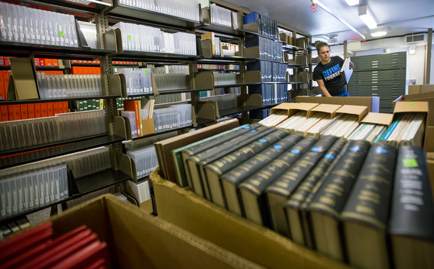 Danielle McGinnis with VonRentzell Movers packs books in the 3rd floor stacks of Love Library South as part of the Learning Commons Project. The shifting of books and journals within Love Library is heralding the start of UNL's Learning Commons project.