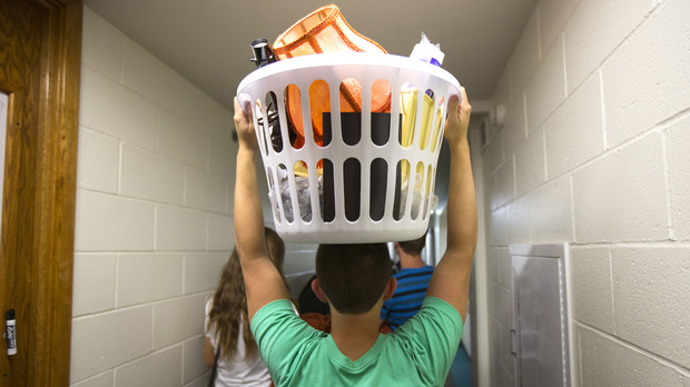 Kyle Beck of Gretna helps a friend move into Abel Residence Hall Thursday afternoon.