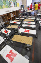 Carts sit at the check in desk in University Suites awaiting new residents.