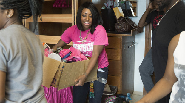 Justice Wright of Omaha unloads boxes in her Smith Residence Hall room Thursday afternoon.