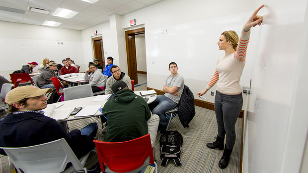 Graduate student Laura Ismet leads a mathematics lecture inside a renovated Brace Hall classroom.