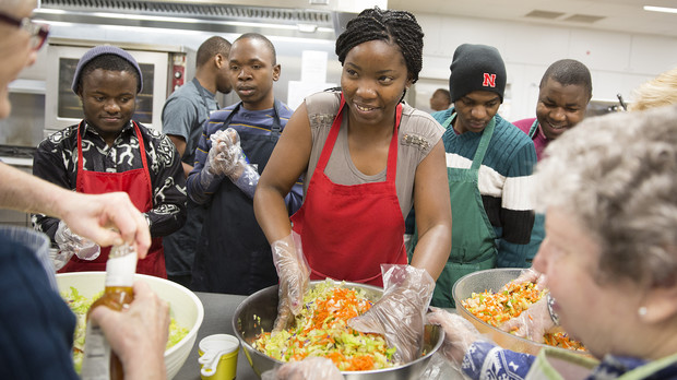 SUSI volunteers prepare to serve lunch at the Matt Talbot Kitchen on Jan. 27. Students in the U.S. Department program on democracy and civic engagement are attending classes at UNL and learning about the region. The students are from Angola, Botswana, Mozambique, South Africa and Zimbabwe.
