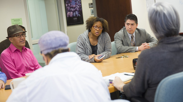 Ethnic studies faculty (from left) Waskar Ari, Jeannette Eileen Jones and Sergio Wals talk with Joseph Francisco, dean of Arts and Sciences, during an April 20 meeting. The group discussed a new UNL policy that will help ethnic studies attract and retain cutting-edge professors.
