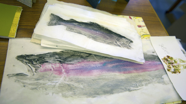 Prints of trout made by senior art student Ashley Bales. The prints led to Bales crafting a book on the lifecycle of a trout.
