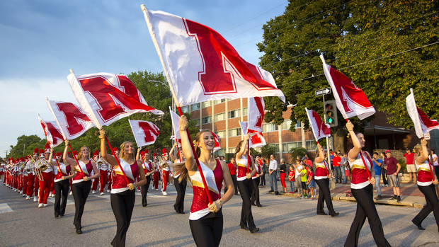 Flag corps members participate in the 2015 Nebraska homecoming parade. The annual parade is Sept. 30.