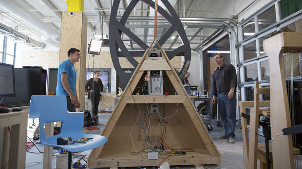 Members of the UNL Maker Club watch as their sculpture design rotates during an initial test in Nebraska Innovation Studio, a maker space based at Nebraska Innovation Campus.