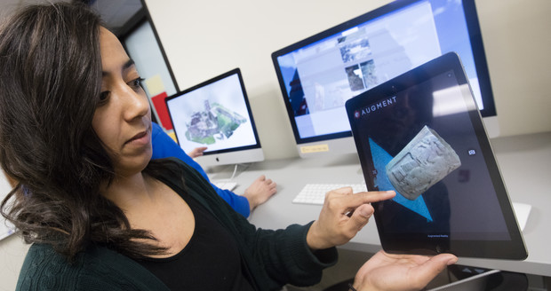 Stephanie Sterling, a December 2015 graduate in Anthropology, demonstrates 3-D software to view a carved column.