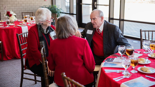 Nancy Busch (from left), dean of the University Libraries, and Virginia Nelson speak to Don Hall Sr., after the March 28 dedication ceremony. Don and Adele Coryell Hall were married for nearly 60 years.