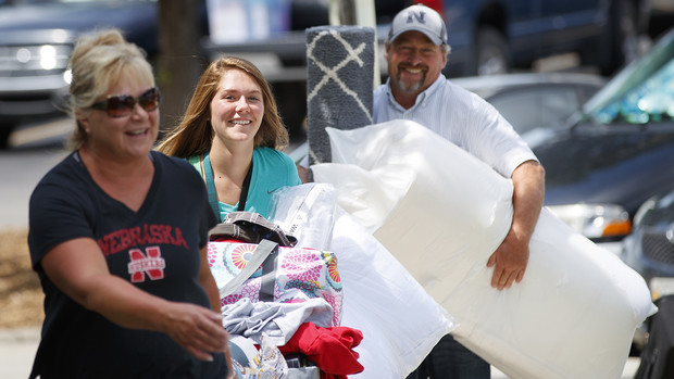 Jayden DeCora and her parents carry items into a residence hall during Nebraska's 2016 move-in. The 2017 move-in begins Aug. 13.