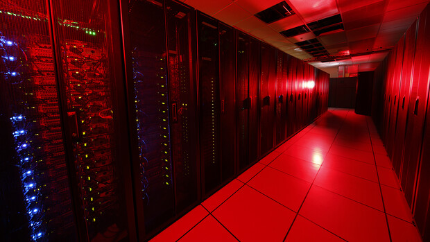 Servers in the Schorr Center, home to the Holland Computing Center, lit up to appear red.