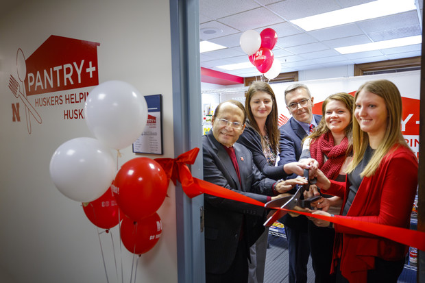 Vice Chancellor for Student Affairs Juan Franco, left, with Chancellor Ronnie Green and others at Jan. 9's grand opening of the Huskers Helping Huskers Pantry+ grand opening.
