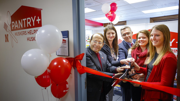 Juan Franco (left) helps celebrate the opening of Nebraska's food pantry for students with Chancellor Ronnie Green (third from left) and others.