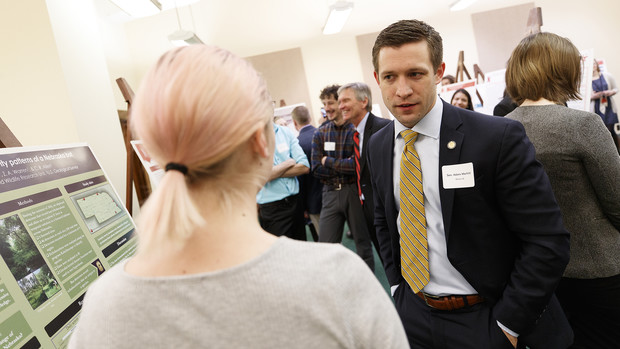 Nebraska Sen. Adam Morfeld talks about a research project with an undergraduate scientist during a 2017 Spring Research Fair event.