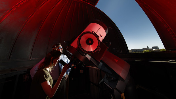 Michael Sibbernsen (right) and Hannah Paxton use the observatory atop the Stadium Parking Garage at the University of Nebraska–Lincoln. The university will use the observatory to record the Aug. 21 total solar eclipse.