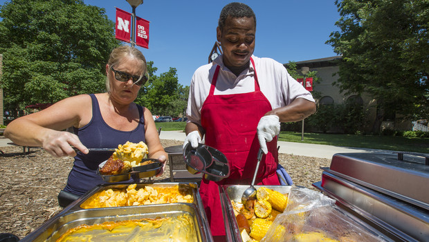 .Kathryn Sildmets and Ron White dish up smoked mac and cheese (left) and New Orleans shrimp boil during a June 16 grill out.