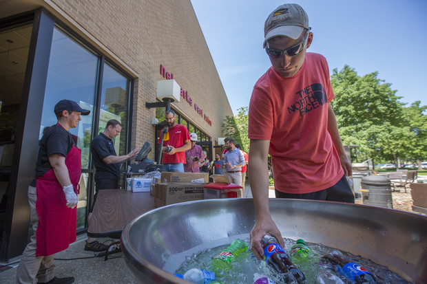 Nick Garst, a graduate student in agronomy and horticulture, searches for a drink during an East Union Café and Grill summer grill out. Meals, which include a main dish, side and drink, are about $6.