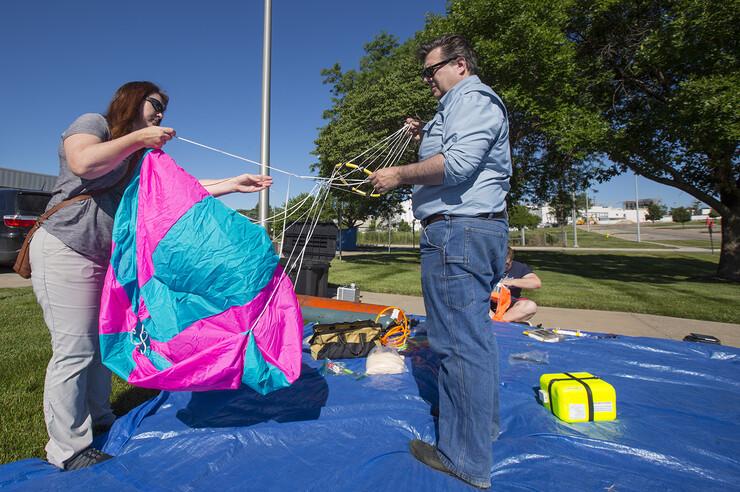 Kendra and Michael Sibbernsen prepare a parachute for a high-altitude balloon release. The Sibbernsens are co-leaders of NASA Nebraska's High Altitude Balloon Program.