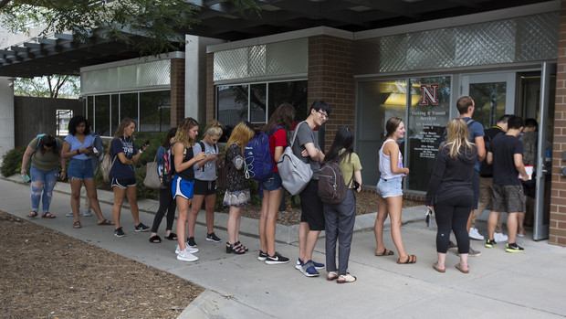 Students stand in line outside Nebraska's parking and transit services office prior to the eclipse.
