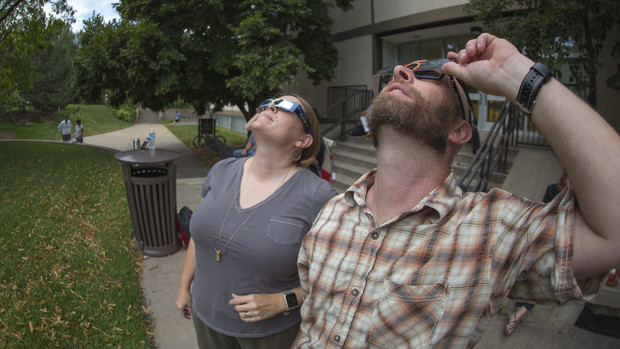Melanie and Michael Reinmiller watch the eclipse after totality.