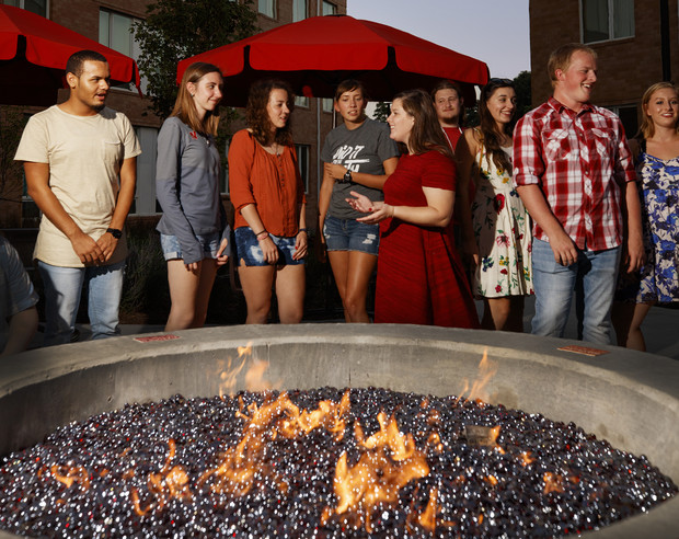 Students gather around the fire pit in the courtyard of Nebraska's Massengale Residential Center.