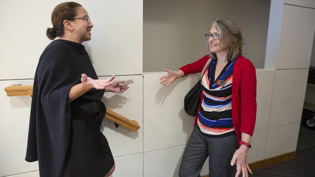 Rona Halualani (left) talks with June Griffin, associate dean for undergraduate education in the College of Arts and Sciences, after the second open forum on Sept. 25.