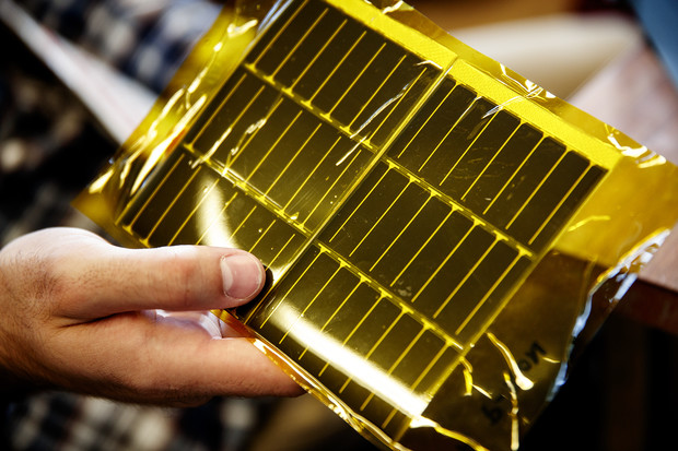 The student's carbon fiber boom design includes flexible solar panels. The panels, shown here, are encased in yellow mylar. A mock panel will be used for the upcoming NASA vibration test.