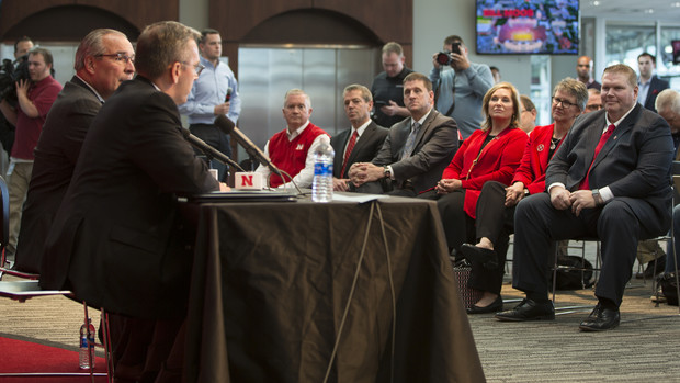 Chancellor Ronnie Green thanks Dave Rimington (right, seated) for serving as Nebraska's interim director of athletics, during the Oct. 15 announcement that Bill Moos has been hired to lead the Huskers.