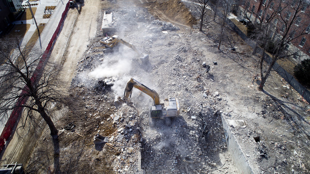 Excavators move rubble on the Cather-Pound implosion site. All rubble is expected to be removed by the week of March 5.
