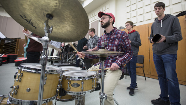 Jonah Payne, a freshman music major, plays in the engine room during Nebraska Steel practice. Payne is the first Husker to play in both Nebraska Steel and Pangea, a steel drum band organized through Lincoln Public Schools.