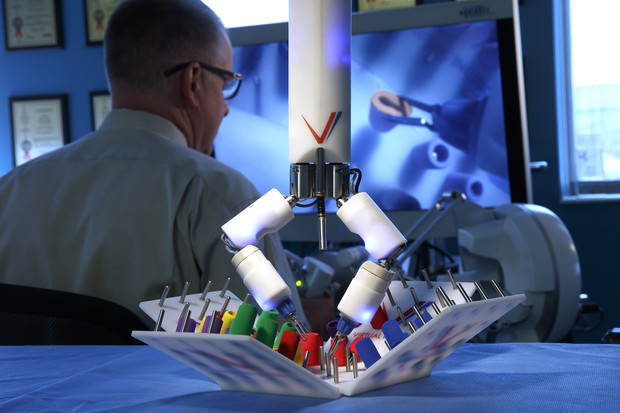 Shane Farritor operates the Virtual Incision surgical robot in the group's previous space at Nebraska Innovation Center.