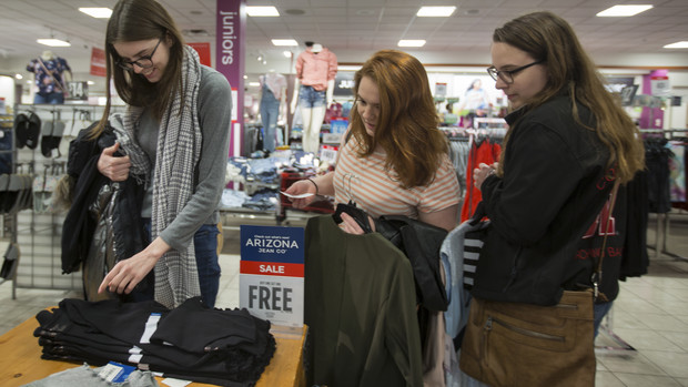 Nebraska juniors (from left) Elizabeth Spaulding, Christina Thibodeau and Marie Wagner consider a shirt purchase during the Suit Up event at the Gateway Mall J.C. Penney.