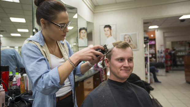 Kyle Murray, a junior professional golf management major from Beatrice, takes advantage of the $10 haircuts offered in the J.C. Penney salon during the April 15 Suit Up event.