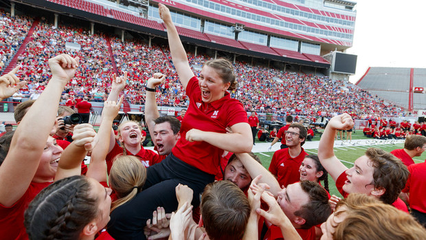 Band members celebrate by lifting Sophia Kallas of Green Bay, Wisconsin, after the junior mellophone player won the march off competition at the Cornhusker Marching Band exhibition on Aug. 17.