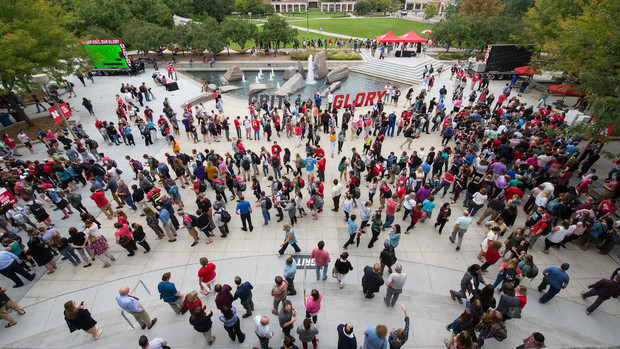 "Students, faculty and staff gather on the Nebraska Union Plaza in celebration of the university's new ""In Our Grit, Our Glory"" celebration."