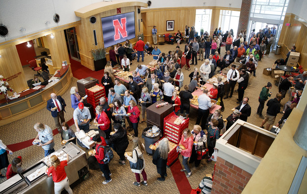 Faculty and staff line up in the Van Brunt Visitors Center to pick up a lunch during the universitywide picnic that followed the service celebration. Fall rains forced food pickup for the picnic indoors.