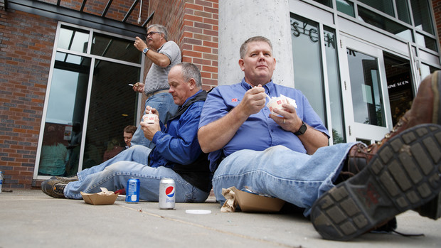 Facilities employees Russ Kraft (right) and Bryan Ludemann enjoy Dairy Store ice cream during the universitywide picnic. Ludemann earned a 10-year Service Award, while Kraft is a seven-year employee at the University of Nebraska–Lincoln.