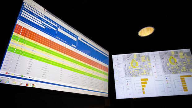 .Screens in the security room within Memorial Stadium outline first responder calls taken during the Purdue game in September. Calls received are coded —red for call received; yellow for first-responder dispatched; green for first-responder on scene; and gray for resolved. The UPD-led game day security team does not leave the stadium until all calls are resolved.