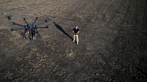 Nebraska's Adam Plowcha flies a drone during a field test in rural Lancaster County. After completing a 20-year career in the U.S. Navy, Plowcha has found a new career path through drone research at the University of Nebraska–Lincoln.