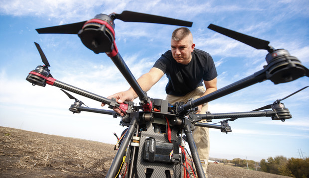 Adam Plowcha makes an adjustment to a drone prior to a test flight in rural Lancaster County. Plowcha served 20 years as a U.S. Navy pilot before seeking his doctorate at Nebraska.