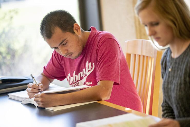 Mauricio Murga Rios studies with a fellow Nebraska Law student in 2018.