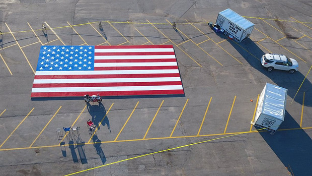 John Lang's Great American Flag project set the Guinness World Record for largest image every built with tiny plastic bricks.