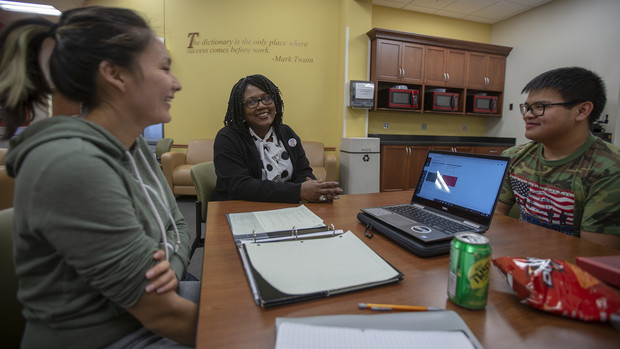 Nebraska's Charlie Foster (center) talks with Huskers Angelica Solomon and Anthony Vu in the OASIS study lounge. Foster was awarded the 2019 Chancellor's Fulfilling the Dream award.