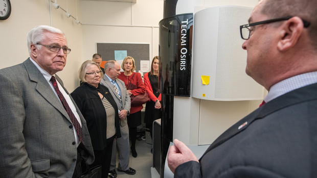 Nebraska's Bob Wilhelm (right) discusses nanoscience research facilities with the NU Board of Regents and university administrators during the Jan. 24 tour.