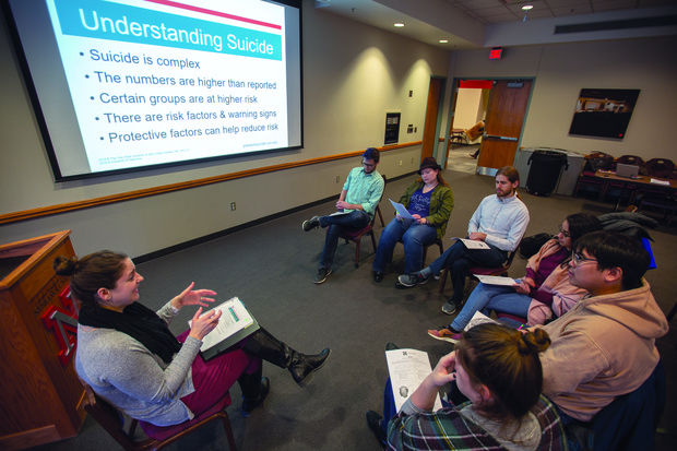Laura Shell (left) leads a REACH training session with members of the Graduate Student Assembly on Jan. 29. The training system was developed by Ohio State University and is going to be the basis of Nebraska's new suicide prevention program.