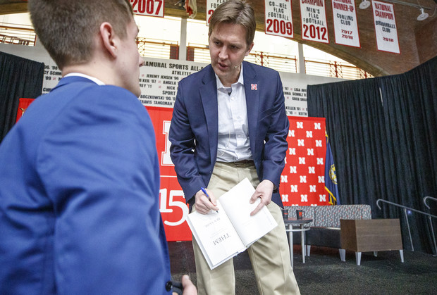 Sen. Ben Sasse autographs a copy of his book for Garrett Streeks, junior from Lincoln, after the Feb. 11 visit.