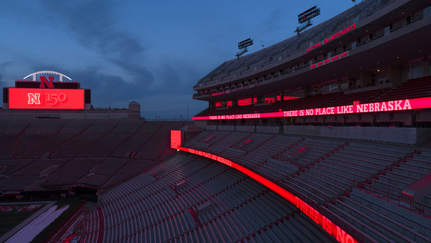 Ribbon boards and scoreboards light the night in Memorial Stadium.