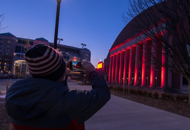 A student pauses to shoot a photo of the Coliseum during the Feb. 14 Glow Big Red event.